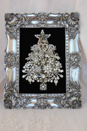 a refined brooch Christmas tree with beads and rhinestones in an embellished silver frame won't take floor space and will be gorgeous