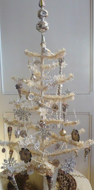 a white Christmas tree with white and silver vintage ornaments and bells plsu silver snowflakes