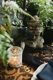 a vintage statuette is a great decoration if you like vintage decor, you can place it anywhere – on the table, steps, mantel and in many other places