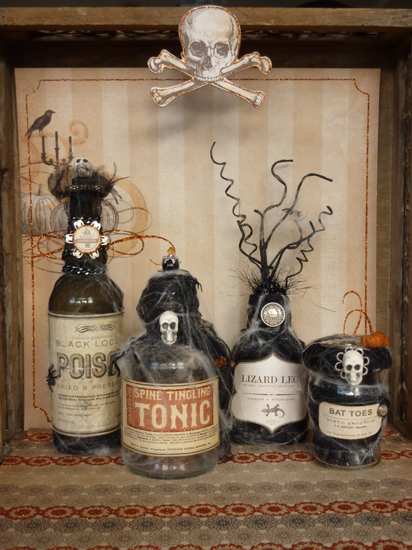 vintage Halloween decor with lovely bottles covered with spider web, skulls and twigs is a very cool and bold solution for decorating or drink styling
