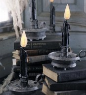 black books and candles in black candleholders are amazing for Halloween decor – place them anywhere you want