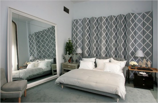 Bedroom With A Large Mirror