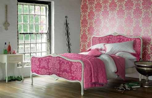 Bedroom With Bold Wallpaper And Bed