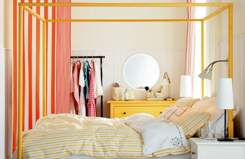 Bedroom With White Walls And Colorful Furniture
