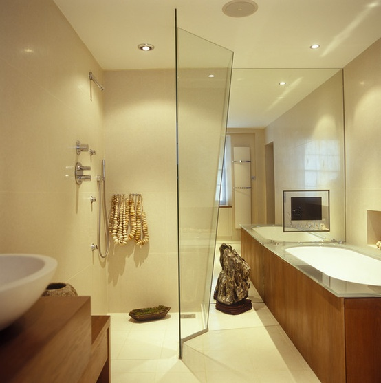 a light beige contemporary bathroom accented with white and rich colored wood items and lights