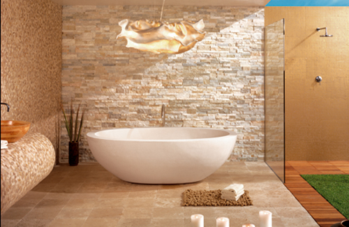 a taupe and gold bathroom done with faux stone, various tiles and wooden panels