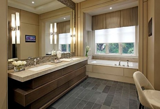 a taupe, brown, grey and creamy bathroom with a sculptural vanity, layered curtains and a large mirror