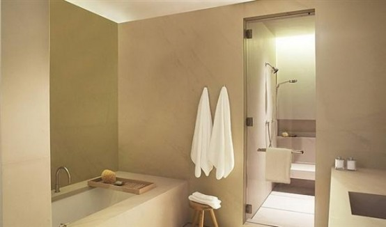 a taupe and white bathroom with touches of dark shades looks very elegant and contemporary
