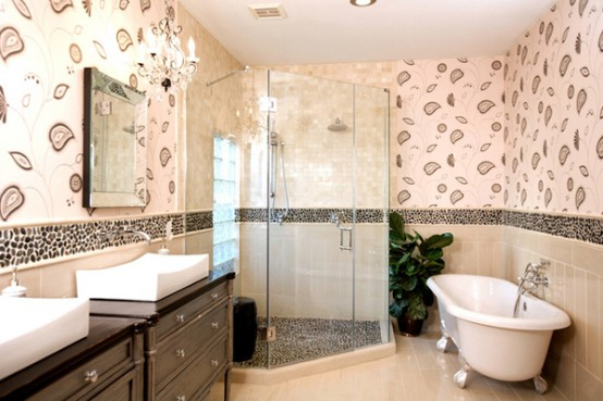 a taupe, beige and brown bathroom with white appliances and touches of various prints here and there
