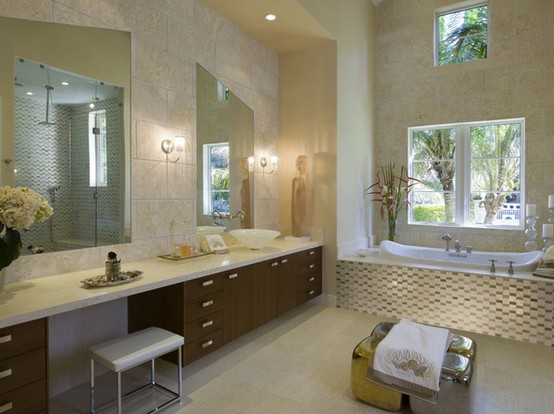 a beige and taupe bathroom with a dark-colored vanity and white surfaces and appliances