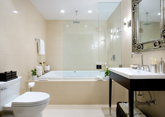 a beige and white bathroom with dark touches is a stylish modern space to rock