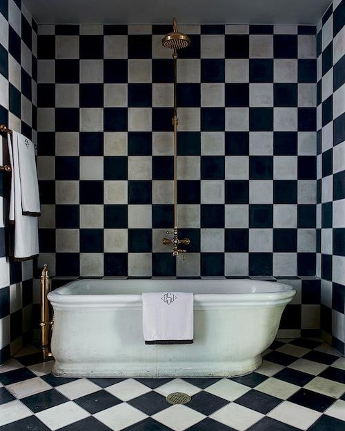 A black and white bathroom could be designed not only in modern but in traditional style too.