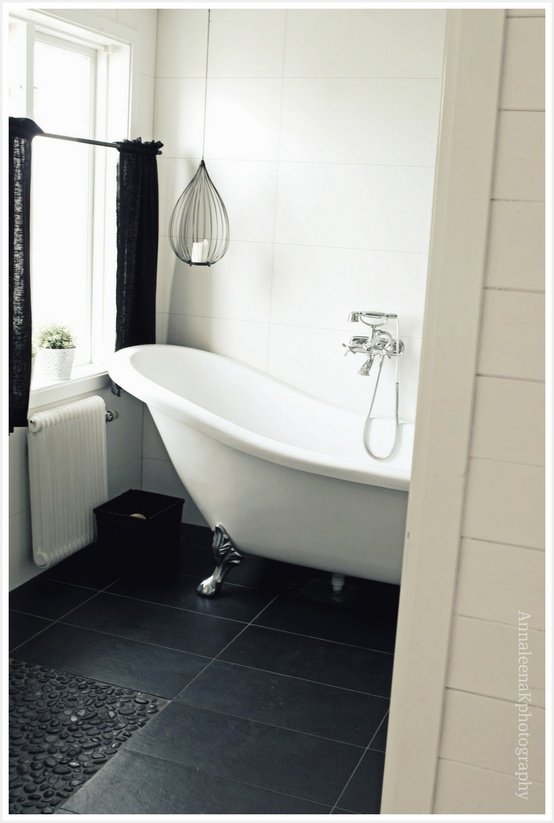 Clawfoot bathtubs looks great in any bathroom but especially great in a black and white one.