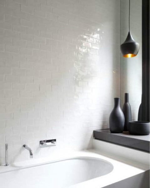 For a white bathroom you could use black pendant lights and black decor items, like vases, to make it more interesting.