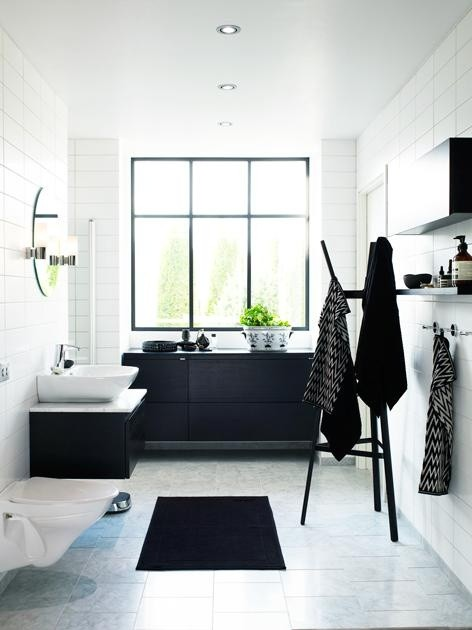 Another way to go is to make all bathroom storage black while everything else - white.