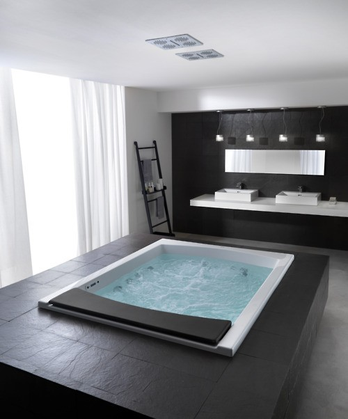 a jacuzzi tub with a black pedestal would become a focal point of any bathroom