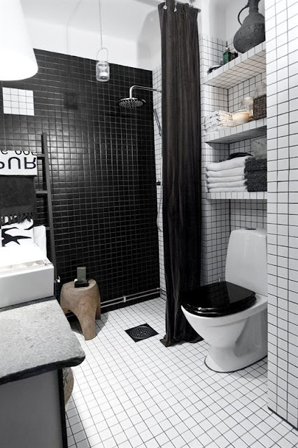 To add some additional contrast you can use  black grout with white tiles. A black toilet seat is also a cool thing to consider.