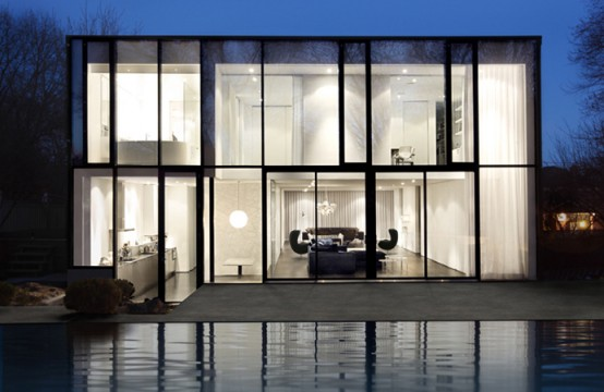 Black And White House With Front And Rear Facades Of Glass