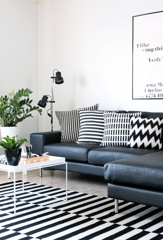 Black and white living room with ikeas rug