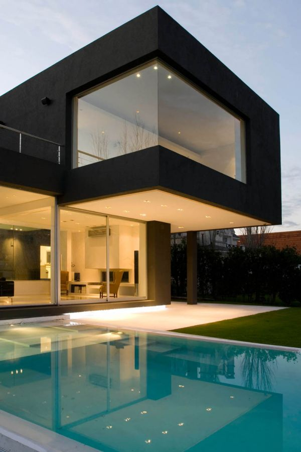 The black house for young couple casa mck digsdigs for Modern house designs with indoor pool
