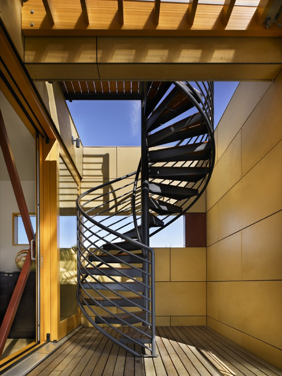 this translucent stair tower knits together two floors of the floating