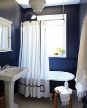 navy walls done with beadboard and paint are spruced up with bright white touches and decor