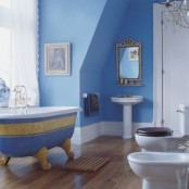 a serenity blue bathroom with gold touches and whiet items plus whimsy and catchy decor