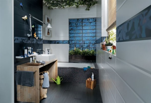 patterned blue tiles on the walls in a neutral bathroom and a wooden vanity for a contemporary bathroom