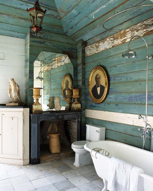 a neutral and turquoise bathroom covered with weathered wooden planks for a shabby chic space