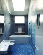 grey concrete paired with mosaic tiles done with an ombre effect from bright blue to white
