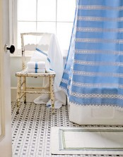 a striped blue curtain can add a colorful accent to the bathroom and make it brighter