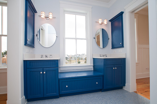 bright blue beadboard furniture and panels and a light blue penny tile floor