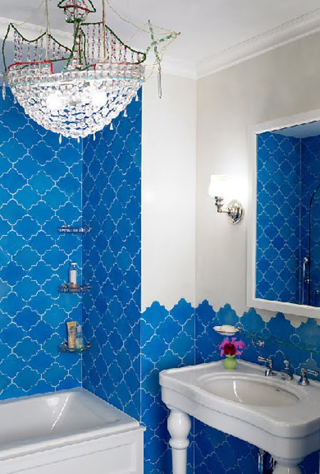 bright blue tiles inspired by Morocco and a crystal chandelier for a bold and modern space