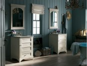 pale turquoise beadboard walls and a clawfoot bathtub with a turquoise bottom