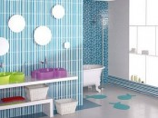 a modern bright blue bathroom with catchy mirrors and colorful sinks for kids