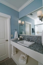 a blue sink space paired with grey tiles on the vanity plus white touches for freshness