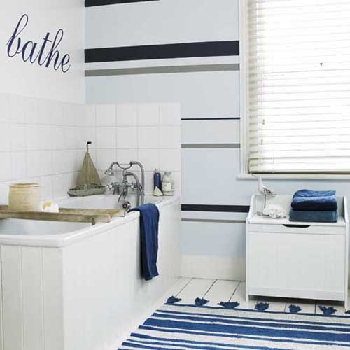 a striped navy and white rug and navy towels may be a nice addition to your bathroom