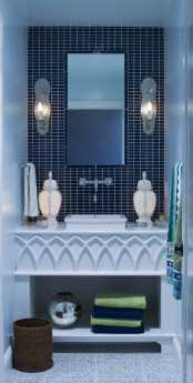 blue and navy tiles, a grey and blue speckled tile floor for a stylish look with a touch of luxury