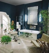 a luxurious midnight blue bathroom with neutrals and touches of mirror plus potted greenery