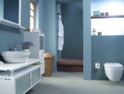 a contemporary matte blue bathroom with touches of white and white furniture