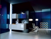 a minimalist navy and blue bathroom with touches of white