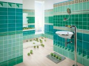 a catchy turquoise and green bathroom with patterned tiles