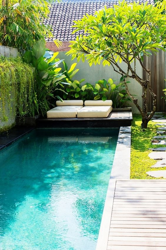 great looking private backyard pool tiles with blue tiles