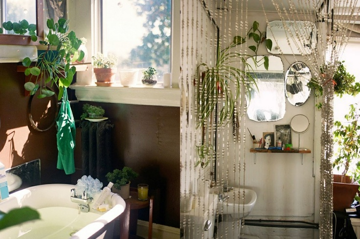 a contemporary bathroom with boho touches   greenery, beaded curtains and an arrangement of mirrors