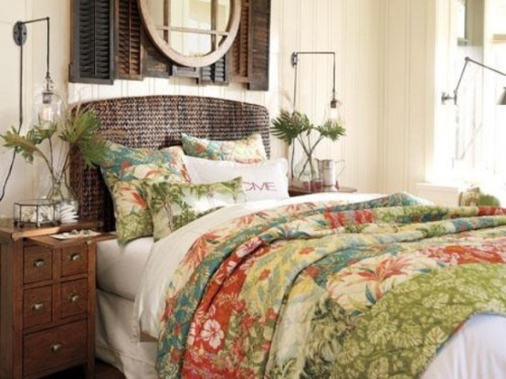 a tropical bedroom with dark stained shutters on the wall, a wicker bed, tropical bedding and palm fronds