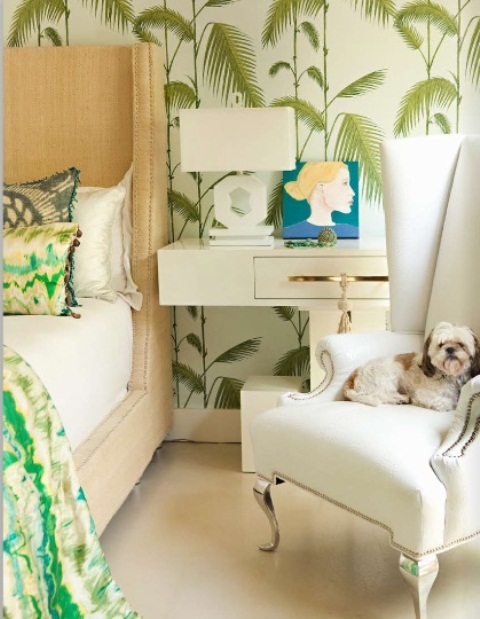 tropical leaf print wallpaper is a timeless idea to turn your bedroom into a tropical oasis, and a neutral upholstered bed matches