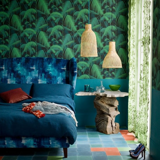 moody tropical print wallpaper, a nightstand made of driftwood and a stone countertop, wicker pendant lamps