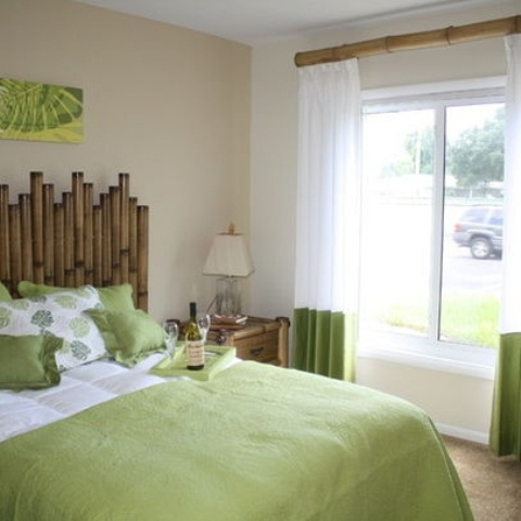 a bamboo headboard and curtain rod, bright green touches for a contemporary and fun bedroom