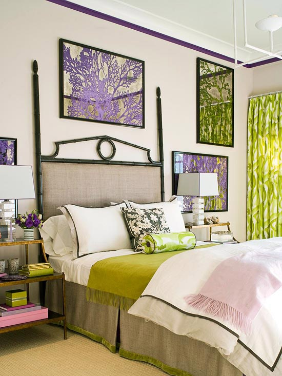 touches of pistachio green and purple make the bedroom bright, and corla artworks add a tropical feel