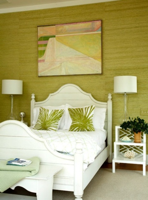 a pistachio statement wall, tropical print pillows and vitnage-inspried white furniture add a tropical feel to the space